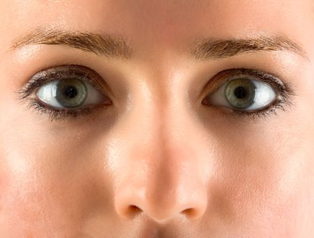 Close up of female face with magnetic eyes