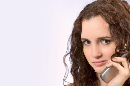 Beautiful Female talks on mobile phone photo