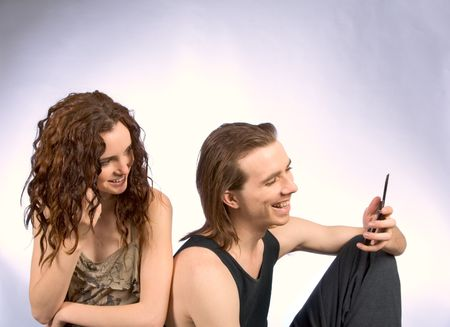 Young Couple talking on cell phones photo