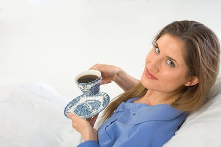 drinking coffee in the bed female looks up Stock Photo - 944508