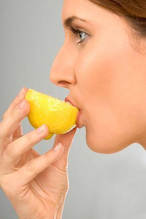 Girl eats fresh lemon Stock Photo - 944509