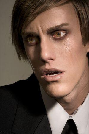 traumatized: shocked male in tears  Stock Photo