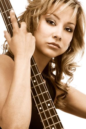 Latina blonde Girl sitting with bass guitar Stock Photo - 1229481