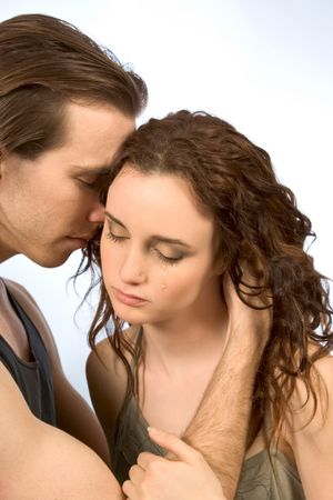 worse: boyfriend comforts young female in tears Stock Photo