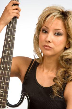 Portrait of Hispanic Girl with guitar neck photo