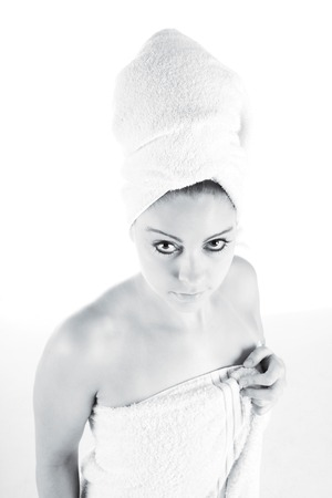 Young Woman  wrapped in clean white bath towel Stock Photo