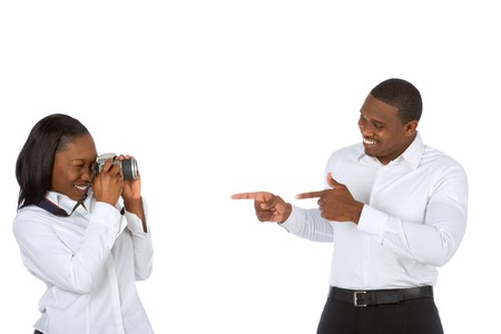 Young female takes pictures of her boyfriend photo