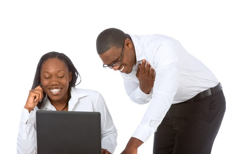 two persons only: African-American young Couple by laptop laughing