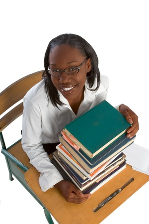 Female African-American Student by stack of books photo