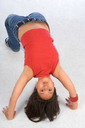 Break dancing girl in bridge pose (high view)