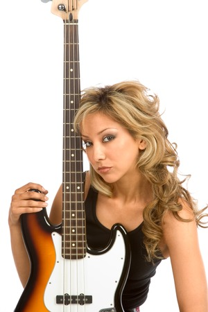 Portrait of Girl with electric bass guitar photo