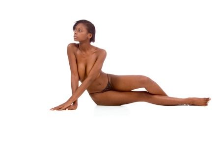 Topless African-American female sitting on the floor photo