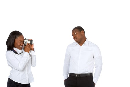 Young African-American female photographs her boyfriend photo