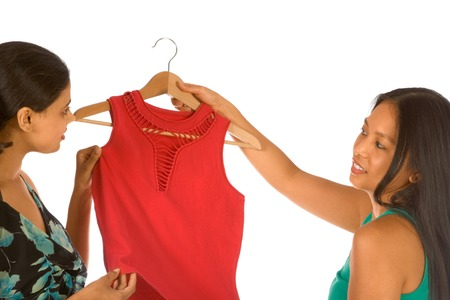Two girls discussing purchasing of new red top photo