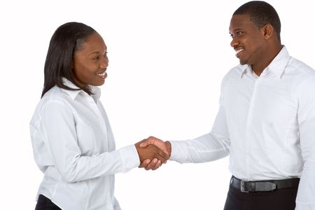 shakes hands: African-American businesswoman shakes hands with businessman Stock Photo