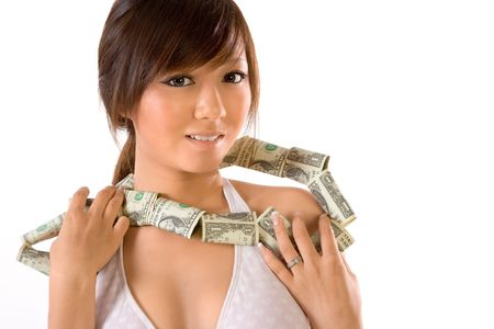 Japanese teenager wearing necklace made of dollar bills Stock Photo - 1859509