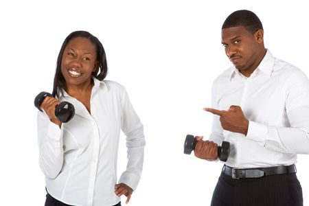 African-American couple competes in dumbbell lifting photo