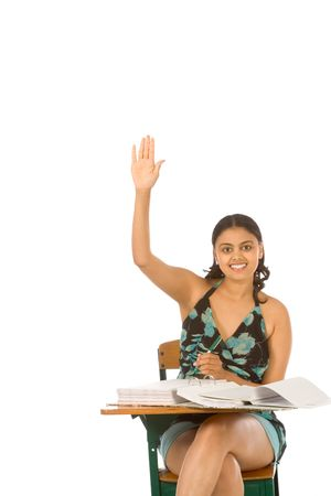 Student rises hand signaling that she is ready to answer Stock Photo