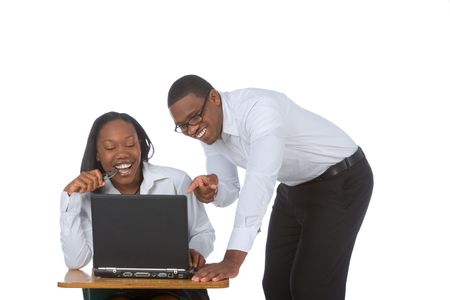 two persons only: Young Couple by laptop laughing