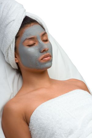 Girl with facial mask (eyes are closed) Stock Photo