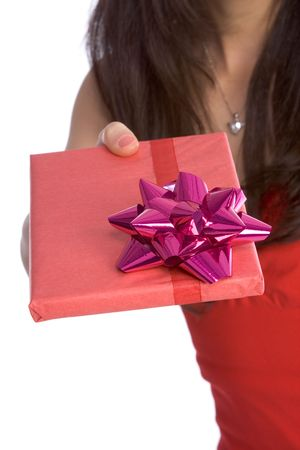 Close up of woman handing wrapped gift Stock Photo - 2034807