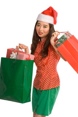 Asian female in Santa hat with bags full of gifts photo