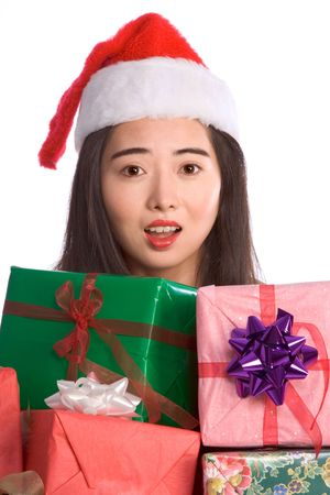 Excited Asian girl with pile of Christmas gifts photo