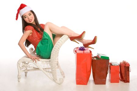 Asian female with Christmas gifts of different sizes photo