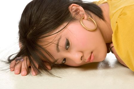 Dreamy Chinese woman Lying On the floor photo