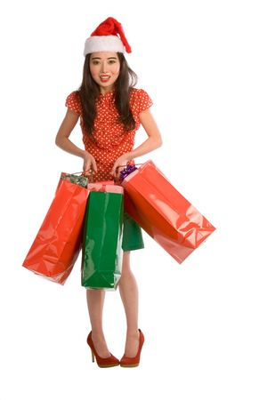 Asian woman holding bags with Christmas gifts photo