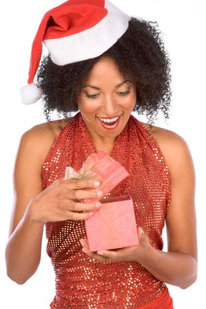Attractive female excited by surprise Christmas present photo