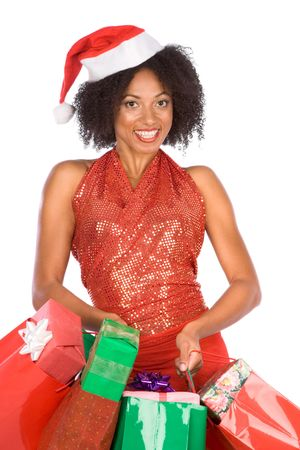 Attractive tanned female in Santa hat with bags full of gifts photo
