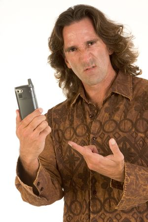 Mid-aged man with long hair apparently frustrated with his cell-phone photo