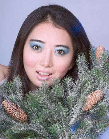 Asian girl by branches of Christmas tree Stock Photo - 2229120