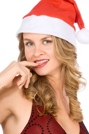 Sexy female in Santa hat with finger in her mouth photo