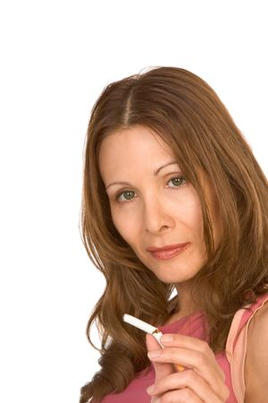 Middle-aged female with long hair shows broken cigarette photo