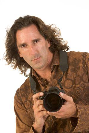 Man with long hair holding DSLR photo camera Stock Photo - 2349371
