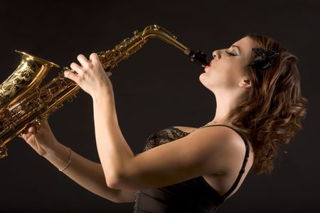 Woman with saxophone in retro lingerie photo