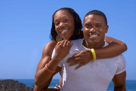 African-American young couple having fun on beach photo