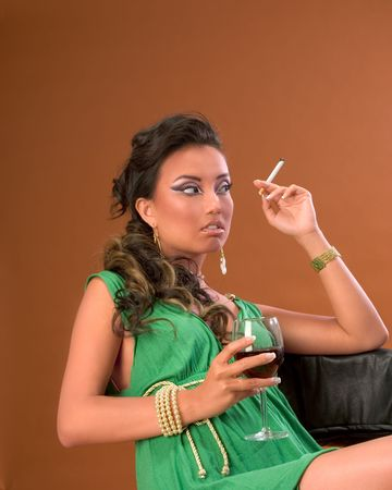 Young woman with cigarette and glass of red wine Stock Photo