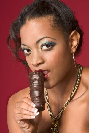 Portrait of young beautiful woman eating chocolate Stock Photo - 2425275