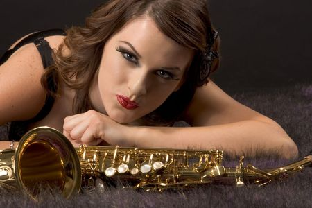 Portrait of female with saxophone in retro lingerie Stock Photo - 2459065