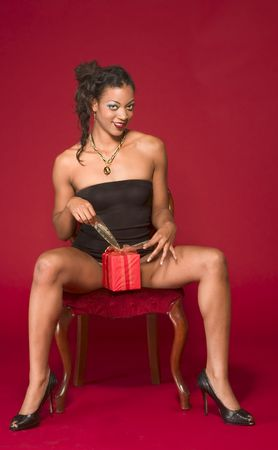 Sexy girl open her Valentine's Day present Stock Photo - 2459037