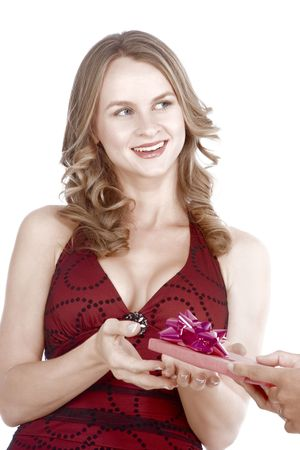 Young attractive female in red dress receiving present package photo