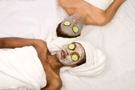 Two girls are relaxing during facial mask application in spa photo