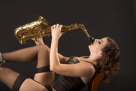 Woman with saxophone in retro lingerie Stock Photo - 2489997