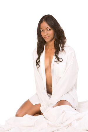Beautiful dark skinned girl in white shirt photo