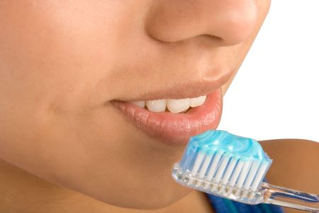 Close up of woman brushing her teeth photo