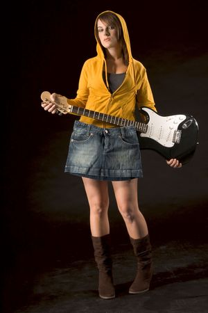 Young female covering herself with skirt hanging from guitar photo