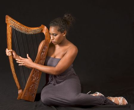 soloist: portrait of young beautiful woman with harp Stock Photo